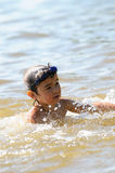Kid in the lake Stock Photos