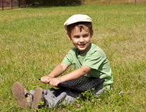 Kid with laptop on grass Royalty Free Stock Photography
