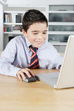 Kid with Laptop at Home Royalty Free Stock Image