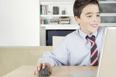 Kid with Laptop at Home Stock Photos