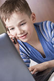 Kid with laptop and phone Royalty Free Stock Image