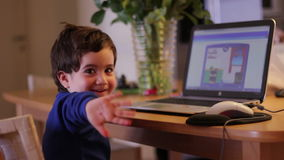 Kid with laptop smile at the camera stock video