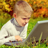 Kid with Laptop Royalty Free Stock Photo