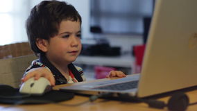 Kid with laptop wave to the camera stock footage