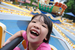 Kid laughing. Asian little kid playing in the amusement park Royalty Free Stock Photography