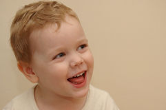 Kid laughing. Portrait of a three year old having fun Royalty Free Stock Photography