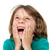 Kid laughing with hands on face. Stock Photos