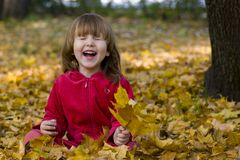 Kid laughing in the park Stock Image