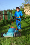 Kid lawn mower Royalty Free Stock Image