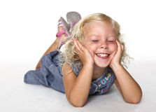 Kid lay down on white Royalty Free Stock Image