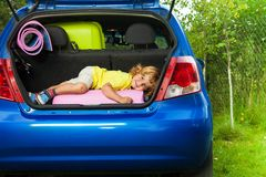 Kid laying on the bags waiting for vacation Royalty Free Stock Images