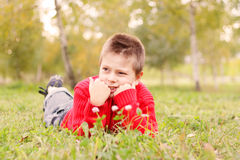 Kid laying down on grass Stock Photos