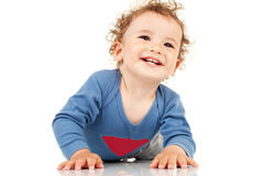 Kid laying down and smiling Stock Photo