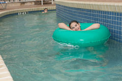 Kid on a lazy river. Location shot of a young girl on a blue/green innertube in a lazy river in Myrtle Beach South Carolina stock images