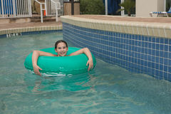 Kid on a lazy river. Location shot of a young girl on a blue/green innertube in a lazy river in Myrtle Beach South Carolina royalty free stock images