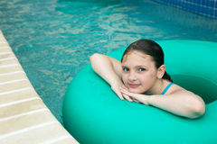 Kid on a lazy river stock photo