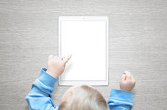 Kid learn to use tablet Stock Images