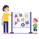 Kid learning abc in kindergarten with teacher. Or tutor. Home learning with mom. Modern flat style color modern vector illustration Stock Photo