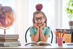 Kid is learning in class. Stock Image