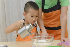 Kid learning to cook Royalty Free Stock Photo