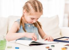 Kid learning to draw with dry pastel stock photo