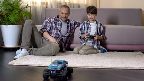 Kid learning to drive car on radio control, expensive gift from sunday father. Stock photo stock photography