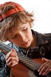 Kid learning to play guitar Stock Photos