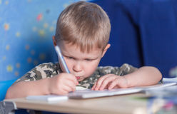Kid learning to write. Preschool boy learning to write education writing Royalty Free Stock Photos