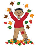 Kid in leaves african american boy Royalty Free Stock Photo