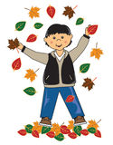 Kid in leaves asian boy Stock Image