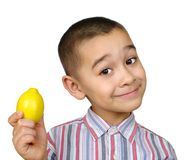 Kid with lemon. Six-year-old hispanic boy holding up a fresh lemon, isolated on pure white background Stock Photos