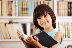 Kid in library Stock Image