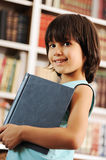 Kid in library Stock Photos