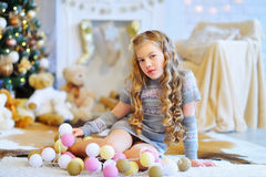 Kid and light garland with lanterns Royalty Free Stock Photo