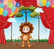 Kid in lion costume on stage Royalty Free Stock Photo