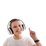 Kid listen music earphones. Isolated white background Stock Photography