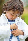 Kid listening to his heart Stock Image