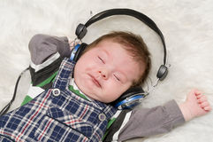Kid listening to music Stock Photography