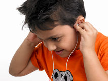 Kid listening to music Royalty Free Stock Images