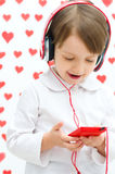 Kid listening to the music Stock Photo