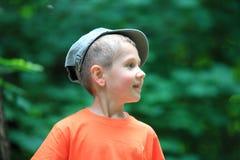 Kid little boy in cap outdoor Stock Images