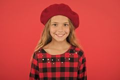 Kid little cute girl smiling face posing in hat red background. Fashionable beret accessory for female. How to wear. French beret. Beret style inspiration. How stock photography