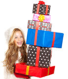 Kid little girl with christmas present stacked Royalty Free Stock Photography