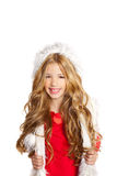 Kid little girl with christmas winter white fur Stock Image