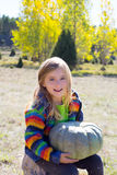 Kid little girl hoding halloween pumpkin in outdoor Stock Photos