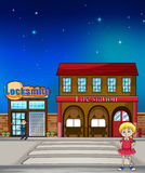 Kid, locksmith and fire station. Illustration of a kid standing before a locksmith and fire station Royalty Free Stock Photography
