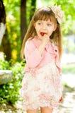 Kid with lollipop Stock Photo
