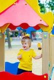 Kid with lolly-pop on the playground Royalty Free Stock Photos