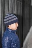 Kid looking away. Boy in a hat and jacket standing Stock Photography