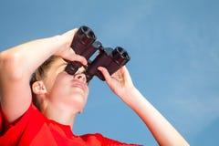 Kid looking through binoculars outdoor Royalty Free Stock Photo